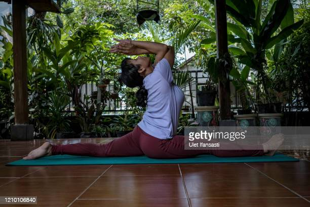 Yoga instructor, Leley, practises morning yoga at her home, as the government closed tourist destinations, schools, offices and urged citizens to...