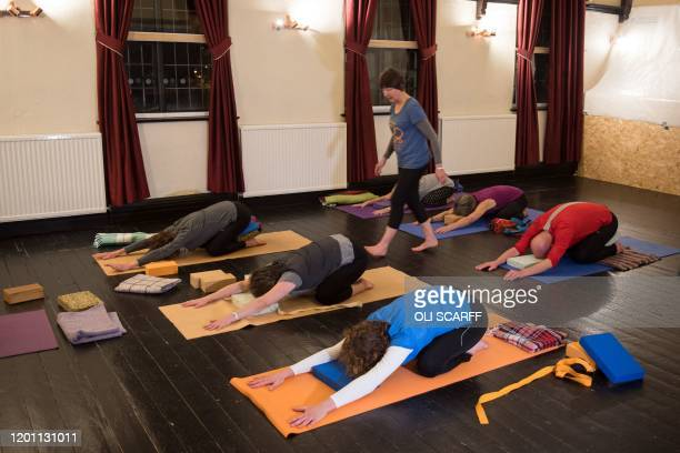 Yoga instructor Pauline Gertig takes a class in the function room of the communityowned Ye Olde Cross pub in Ryton village near Newcastle upon Tyne...
