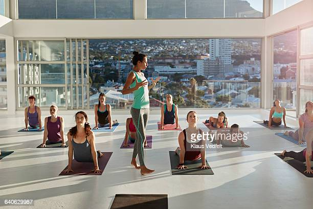 yoga instructor showing breathing exercise - yoga teacher stock pictures, royalty-free photos & images