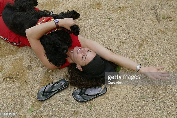 Yoga instructor Suzi Teitelman works with Coali her twoyearold Cocker Spaniel during 'Ruff Yoga' a monthly class for Yoga enthusiasts and their...