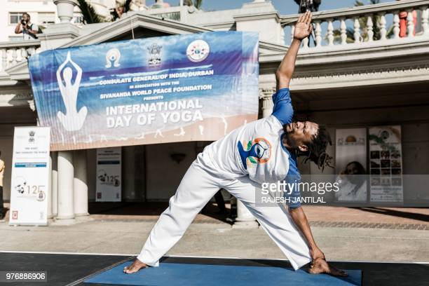 A yoga instructor takes part in a yoga session at North Beach on June 17 2018 in Durban South Africa ahead of the International Day of Yoga on June 21