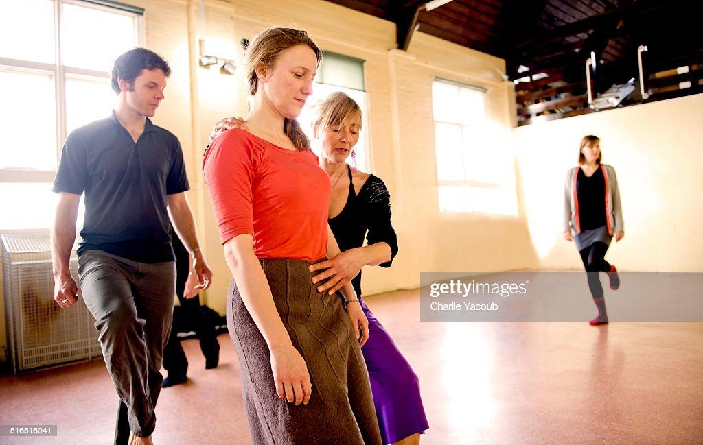 yoga instructor teaching posture for tango : Stock Photo