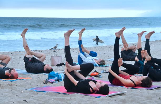 Yoga Instructor Vee Gomez Leads A Beach Cl On An Overcast Evening At Santa Monica In California June 21 2018 To Celebrate