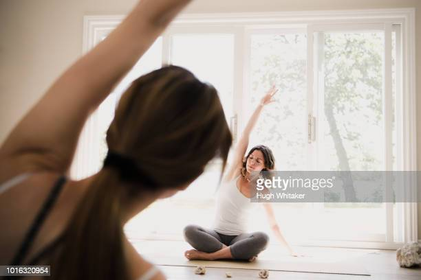 yoga instructor with yogi at retreat - yogi stock photos and pictures