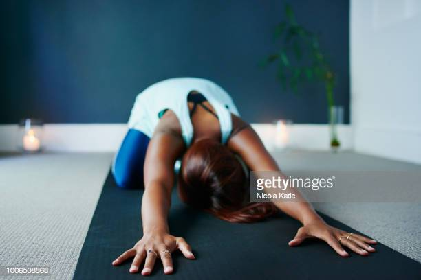 yoga is what relaxes me - childs pose stock photos and pictures