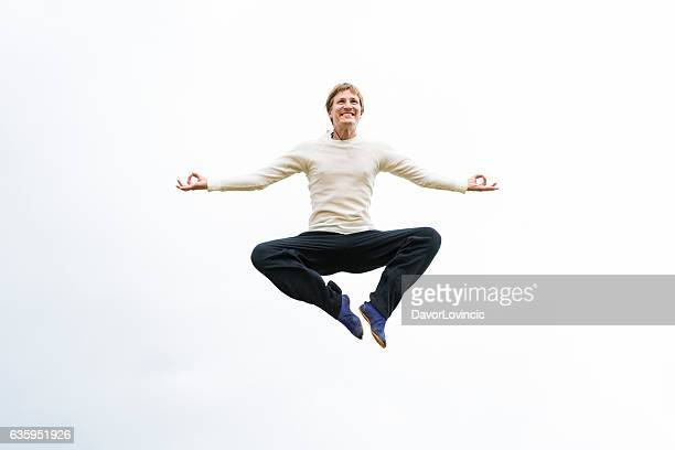 Yoga jumping against sky in Japan