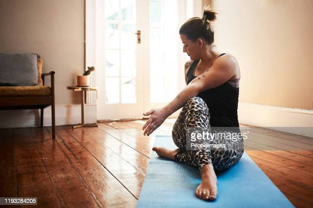 yoga keeps me in the best shape - twisted stock pictures, royalty-free photos & images