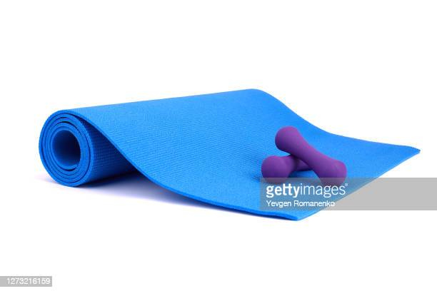 yoga mat and dumbbells isolated on white background - mat stock pictures, royalty-free photos & images