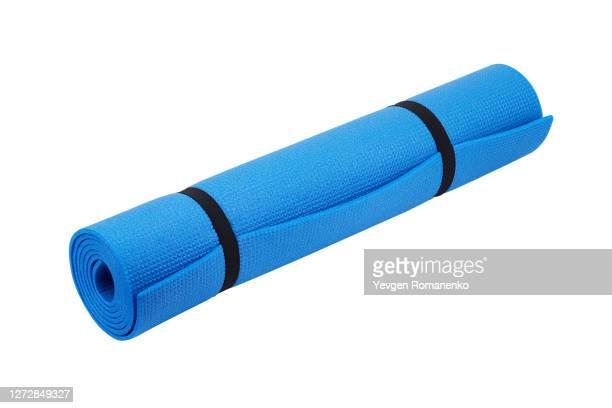 yoga mat isolated on white background - エクササイズマット ストックフォトと画像