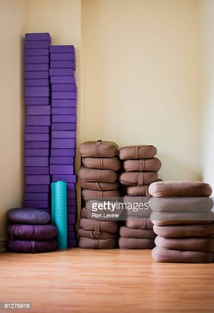 Yoga matt, blocks and pads in a yoga studio