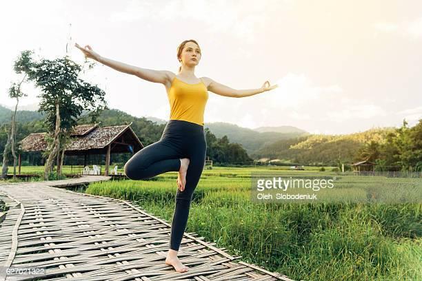 Yoga near the rice field