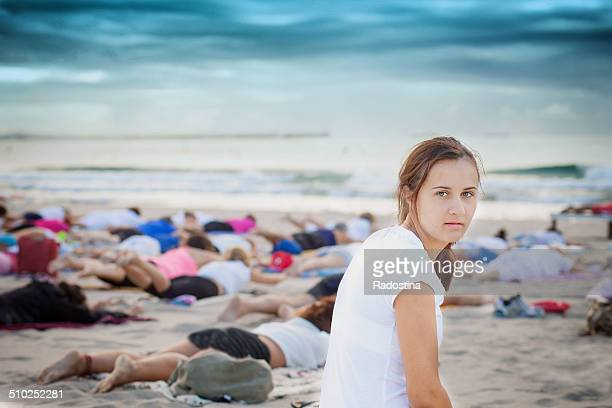 yoga on the beach - eastern european descent stock pictures, royalty-free photos & images