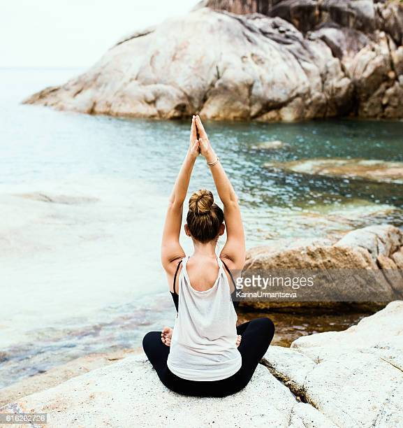yoga on the beach - karina urmantseva stock pictures, royalty-free photos & images