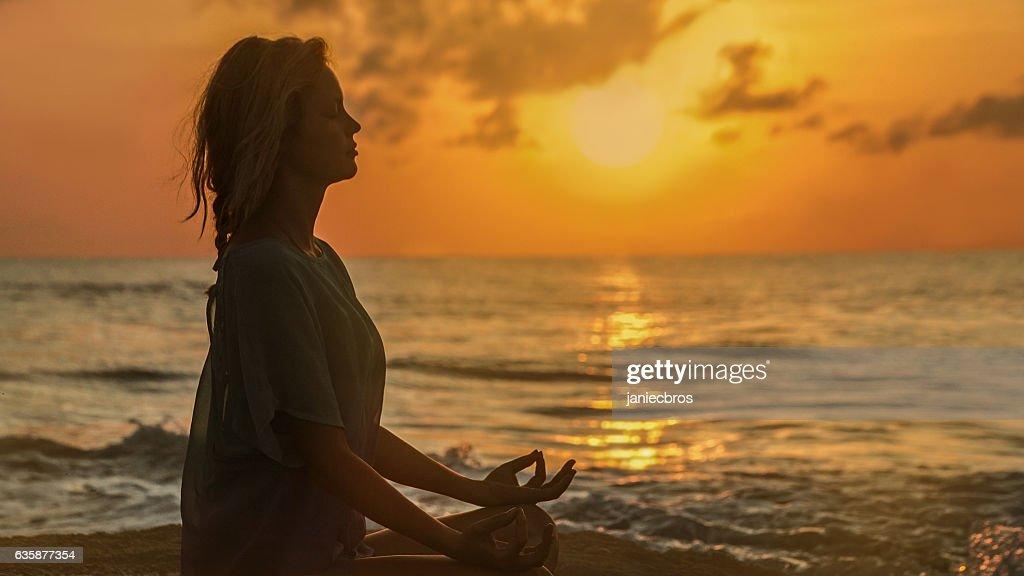 Yoga on the beach : Stock Photo