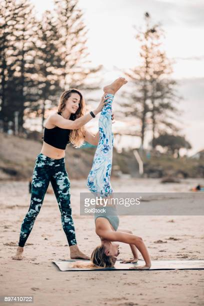 yoga on the beach - yoga pants stock photos and pictures