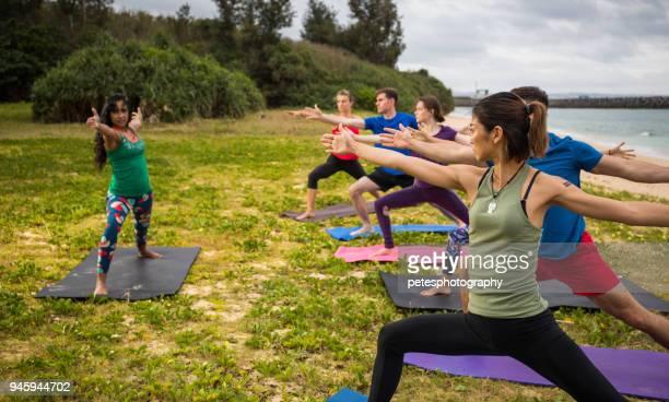 yoga on the beach - yogi stock photos and pictures