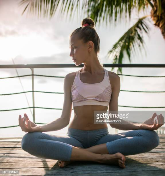 yoga on the pier - karina urmantseva stock pictures, royalty-free photos & images