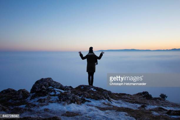 yoga over the clouds - one young woman only stock pictures, royalty-free photos & images