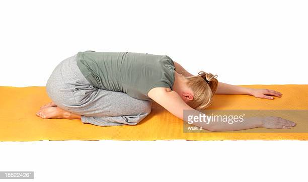yoga position on floor - praying