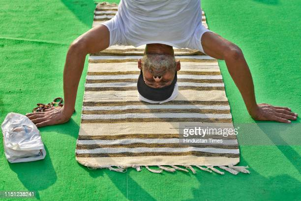 A yoga practitioner participates in a mass yoga session on International Yoga Day at Rajpath on June 21 2019 in New Delhi India The International Day...