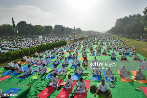 Yoga practitioners participate in a mass yoga session on International Yoga Day at Rajpath on June 21 2019 in New Delhi India The International Day...