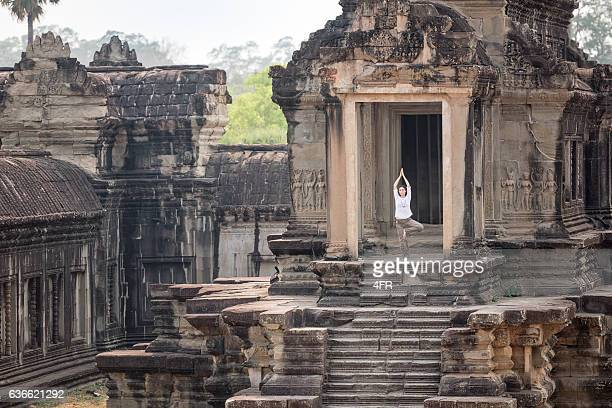 Yoga Retreat, Woman meditating, Angkor Wat, Cambodia