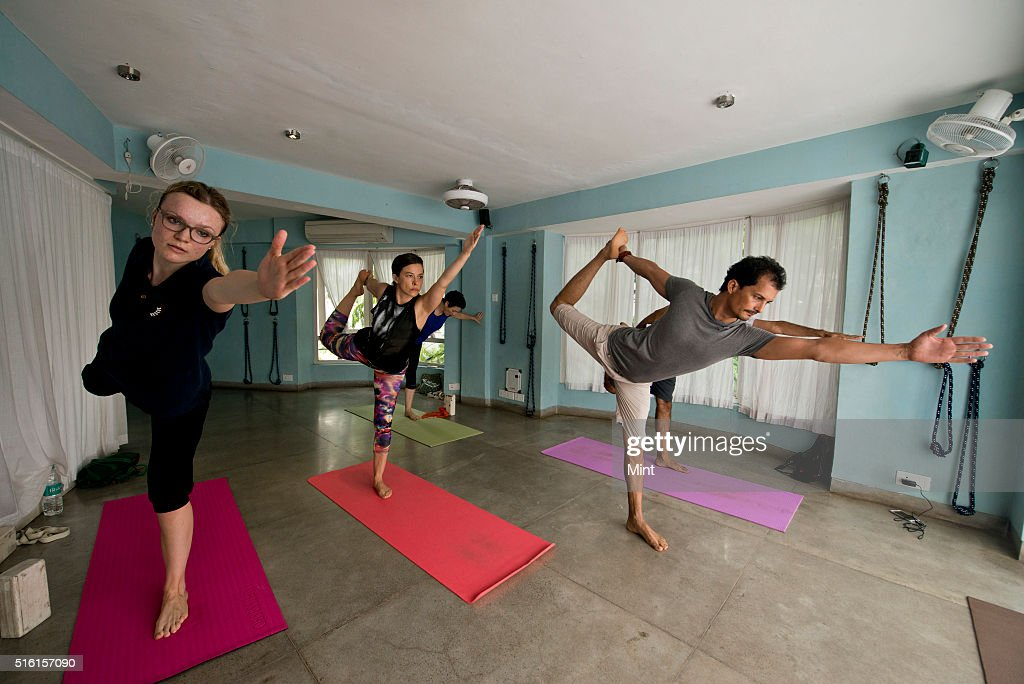 A yoga session in progress at Bandra's Yoga House on June 15, 2015 in Mumbai, India.
