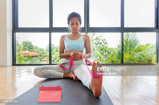 yoga strap to help improve flexibility - strap stock pictures, royalty-free photos & images