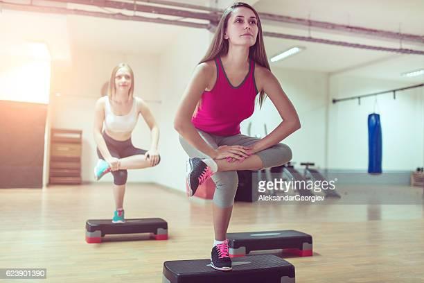 Yoga Stretching on One Leg in Gym Before Aerobics Training