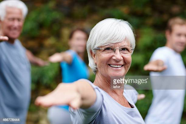 yoga takes me to my happy place - active senior stock photos and pictures