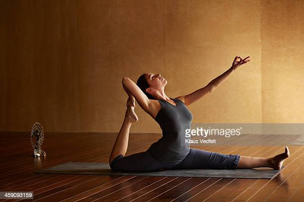 Yoga teacher doing seated stretching