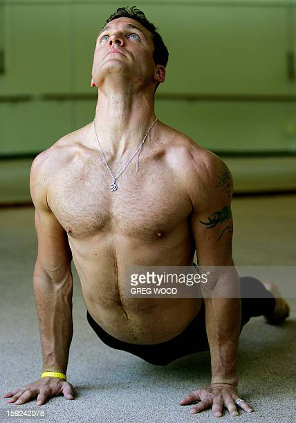 Yoga teacher Duncan Peak a former parachute officer and firstgrade rugby player performs an upward facing dog in Sydney 22 September 2005 Increasing...