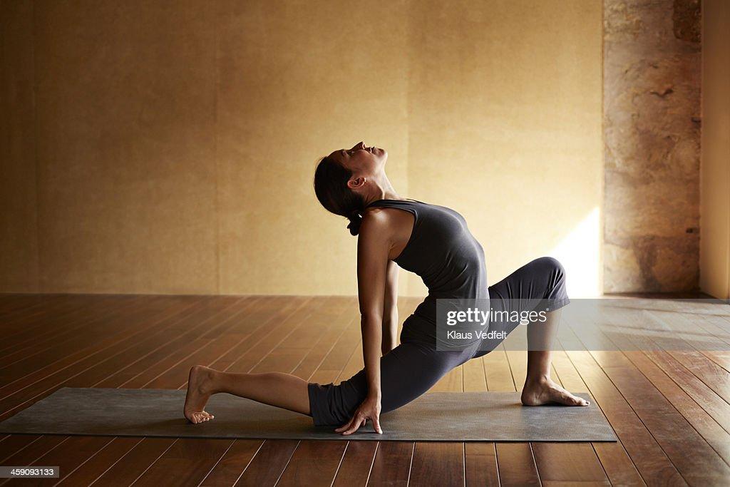 Yoga teacher,  High Lunge, Variation : Stock Photo