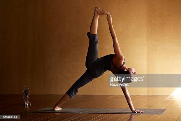 Yoga teacher posing a standing split