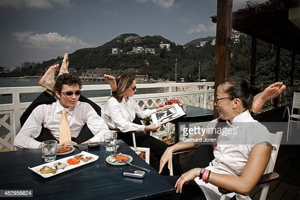 Yoga teachers Julie Choi Samantha Russel and Alexander Medin all living in Hong Kong chatting at Cococabana restaurant in Deep Water Bay Hong Kong...