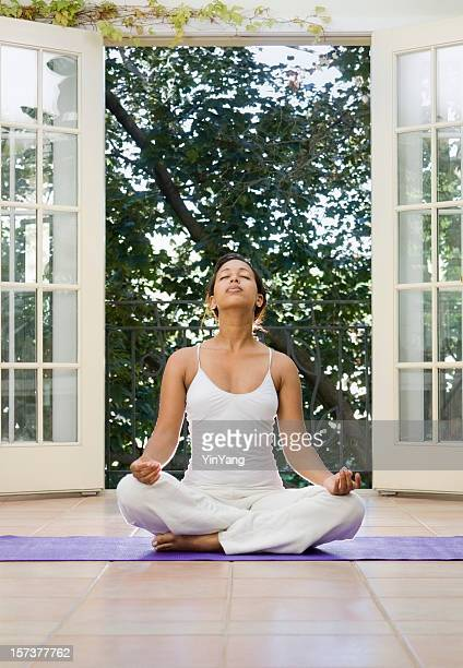 Yoga Woman in Zen Meditation and Exercising at Home Spa