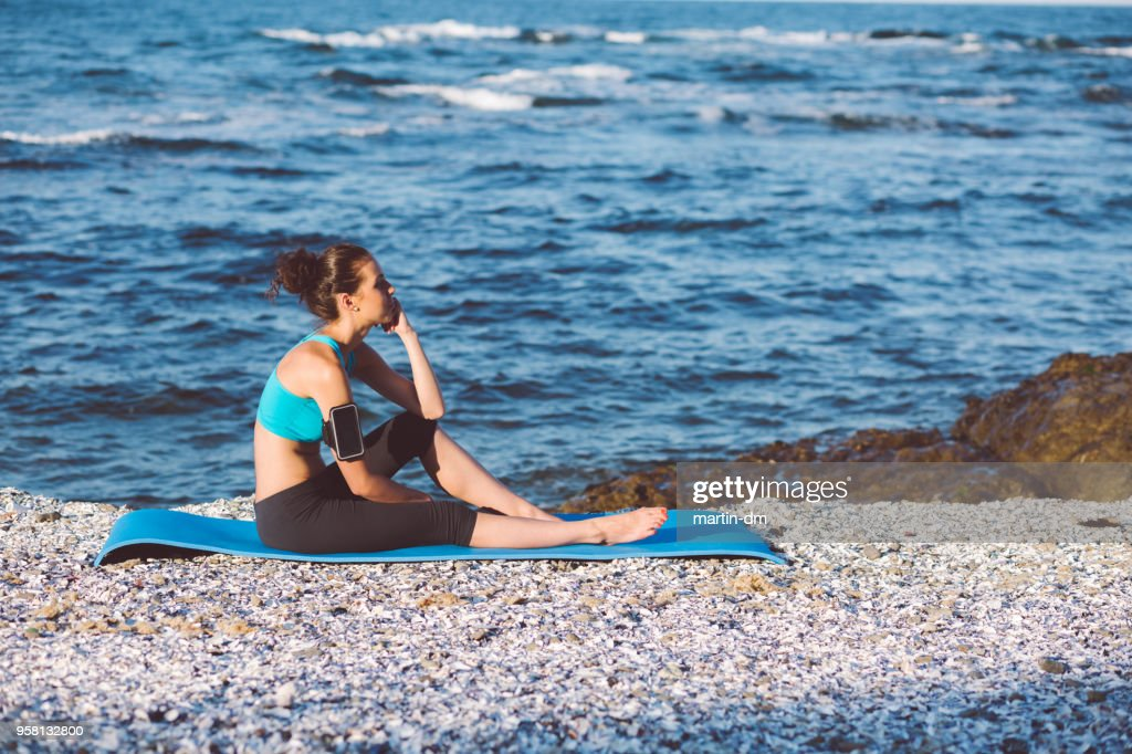 yoga woman relaxing at the beach stock photo getty images