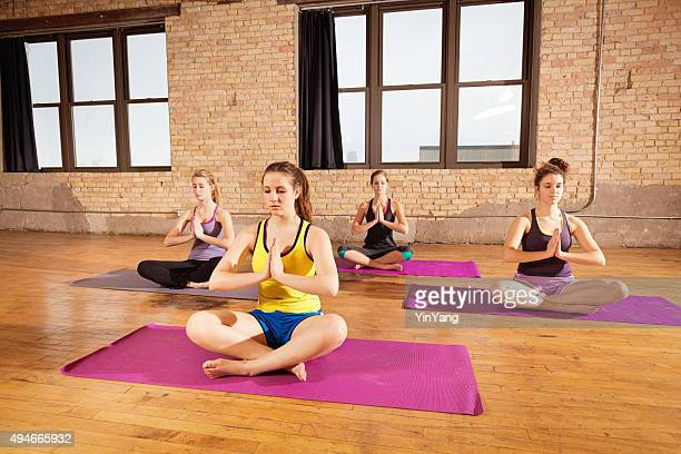 Yoga Workout Class, Group of Young Women Practicing Pose