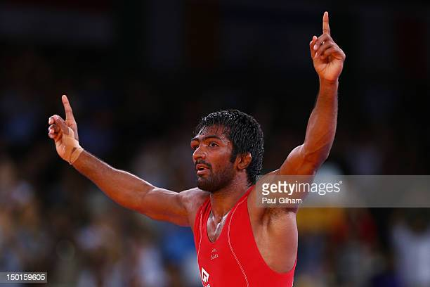 Yogeshwar Dutt of India celebrates defeating Jong Myong Ri of DPR Korea in the Men's Freestyle 60 kg Wrestling on Day 15 of the London 2012 Olympic...
