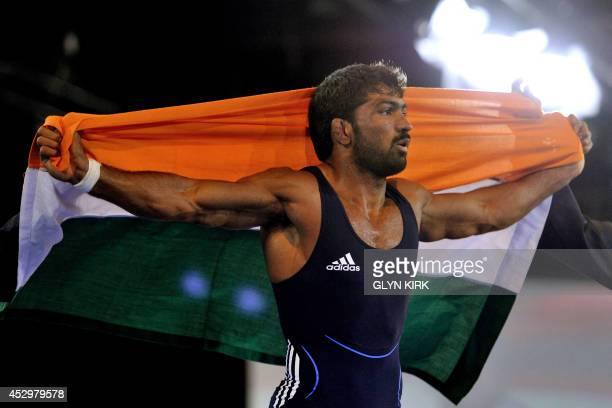 Yogeshwar Dutt of India celebrates winning against Jevon Balfour of Canada in the Men's Freestyle 65kg Freestyle Wrestling Gold medal match at the...
