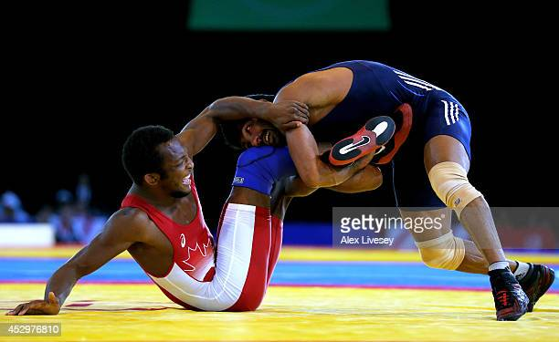 Yogeshwar Dutt of India competes against Jevon Balfour of Canada in the Men's FS 65 kg Gold medal match at Scottish Exhibition and Conference Centre...
