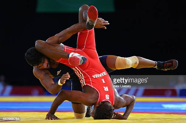 Yogeshwar Dutt of India defeats Chamara Perera of Sri Lanka in the Semi Final of the 65kg Men's Wrestling at Scottish Exhibition And Conference...