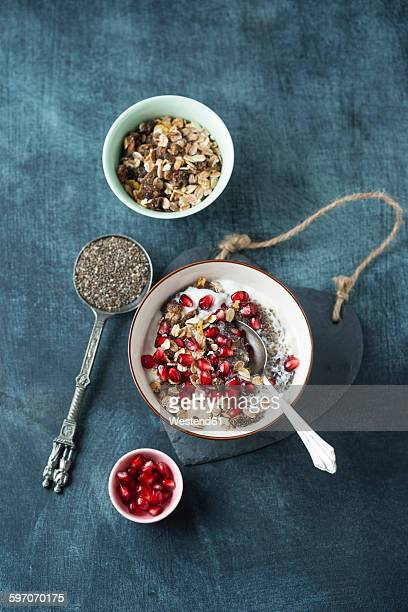 Yoghurt with chia seed, pomegranate seeds and fruit muesli