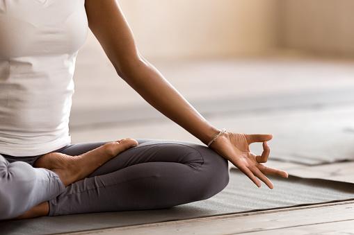 Yogi black woman practicing yoga lesson, doing Ardha Padmasana exercise 1076947060