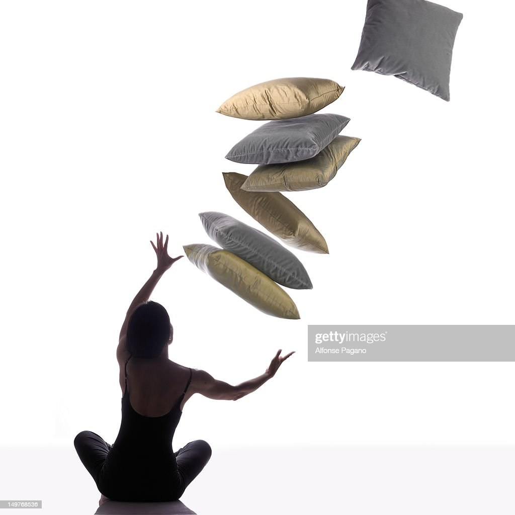 Yogi catching pillows : Stock Photo