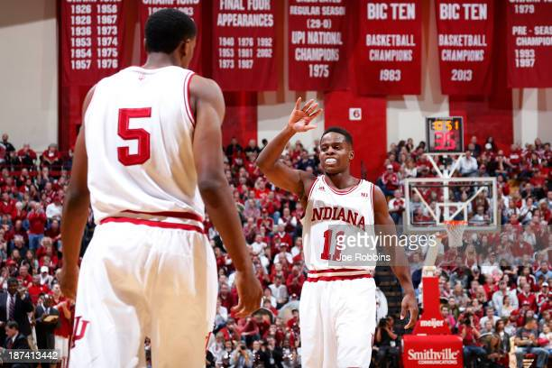 Yogi Ferrell and Troy Williams of the Indiana Hoosiers celebrate against the Chicago State Cougars during first half action at Assembly Hall on...