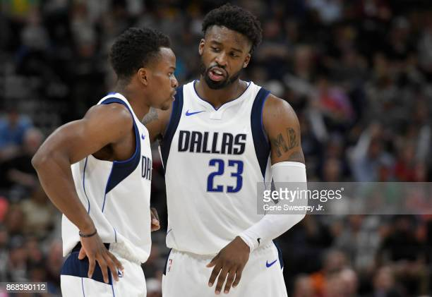 Yogi Ferrell and Wesley Matthews of the Dallas Mavericks talk in the second half of their 10489 loss to the Utah Jazz at Vivint Smart Home Arena on...