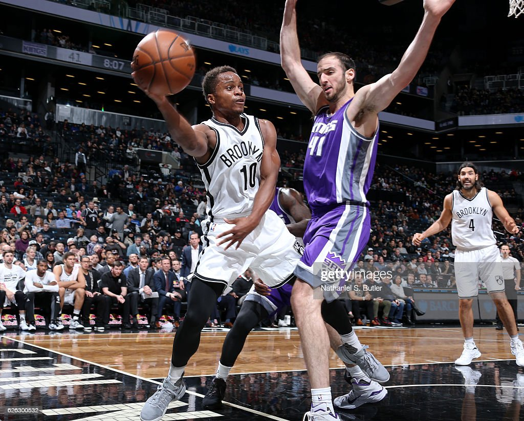 Yogi Ferrell #10 of the Brooklyn Nets passes the ball while guarded by Kosta Koufos #41 of the Sacramento Kings on November 27, 2016 at Barclays Center in Brooklyn, NY.