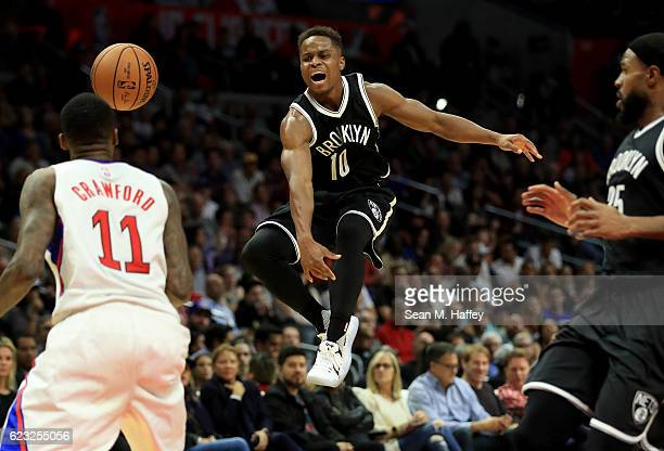 Yogi Ferrell of the Brooklyn Nets reacts to losing the ball as Jamal Crawford of the Los Angeles Clippers defends during the second half of a game at...