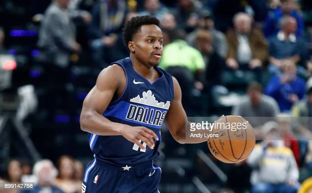 Yogi Ferrell of the Dallas Mavericks dribbles the ball against the Indiana Pacers during the game at Bankers Life Fieldhouse on December 27 2017 in...
